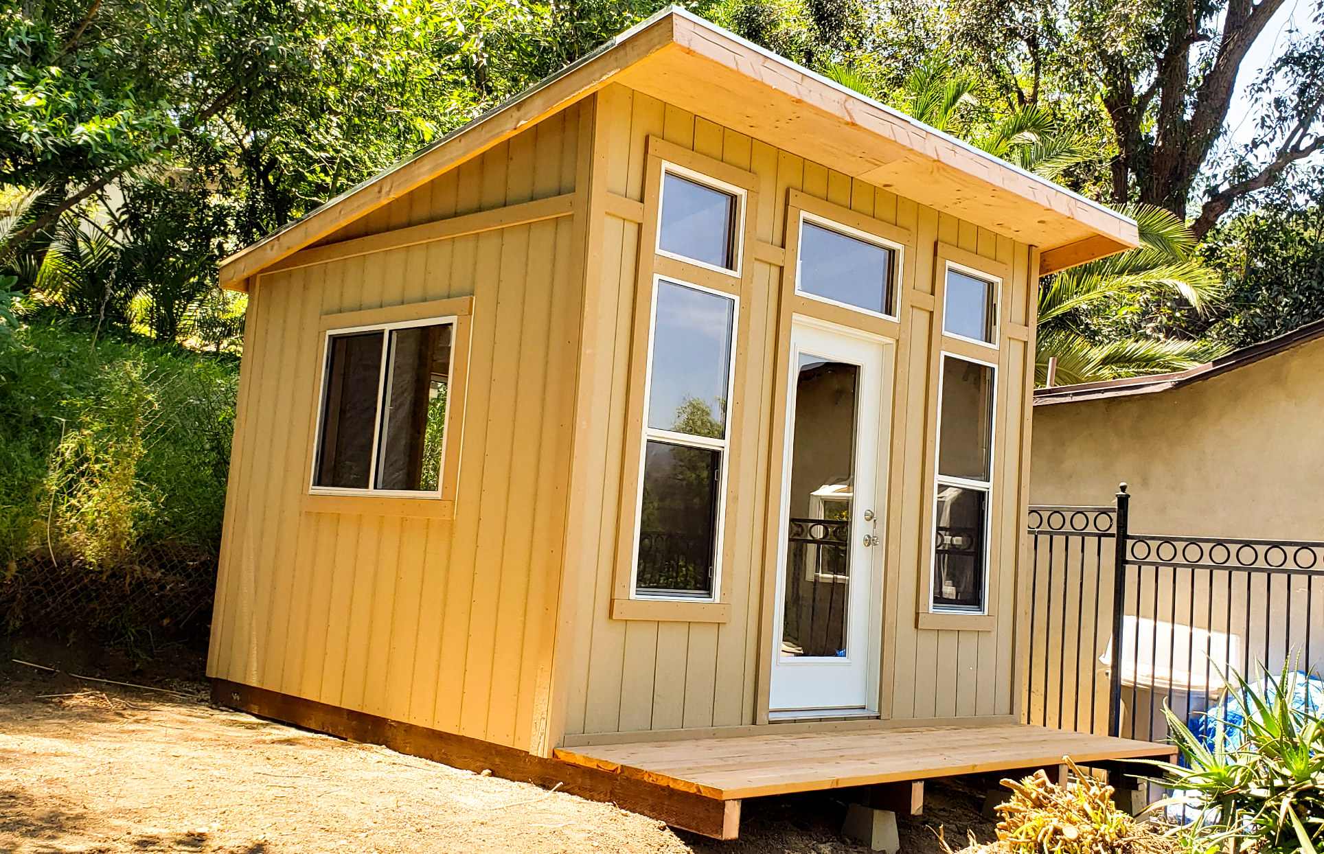 10 x 12 Studio Shed shown with optional windows added and front deck