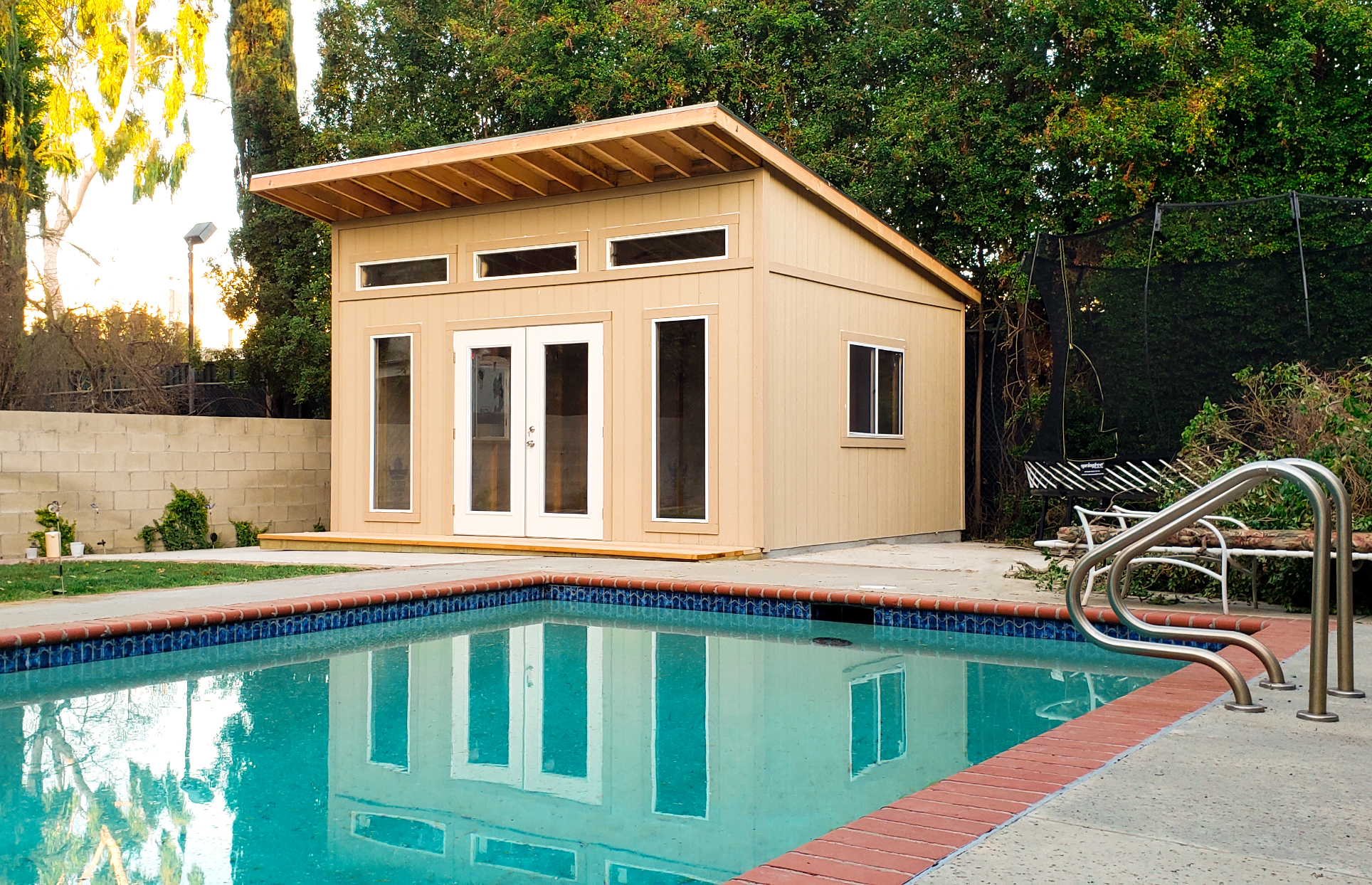 16 x 24 Studio Shed with optional double french doors, windows, front deck, and extended front overhang